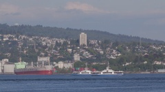 Two ferry boats pass each other while they cross the Burrard Inlet in vancouver Stock Footage