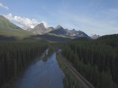 Morants Curve Lake Louise Banff Jasper National Park over water aerial Stock Footage