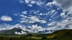 Clouds float above mountains Stock Footage