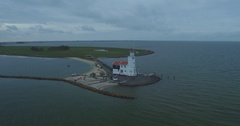 Lighthouse of marken aerial shot with drone going around Stock Footage