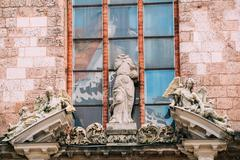 Riga Latvia. Three Ancient Baroque Statues On Top Of Portal Of Main Entrance To Stock Photos