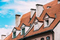 Riga Latvia. Mansard Tile Roof With Four Gable Fronted Dormer Windows On The Old Stock Photos