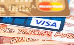 VISA and Mastercard Debit Card lying over banknotes of russian rubles Stock Photos
