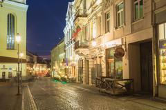 Vilnius Lithuania. Pilies Street Of Old Town In Bright Evening Illumination Stock Photos