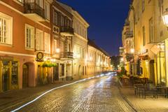 Vilnius Lithuania. View Of Deserted Pilies Street In Bright Evening Illumination Stock Photos