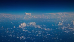 Flying over vivid blue sea above the clouds Stock Footage