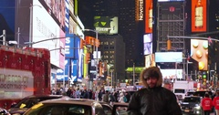 Night Establishing Shot of Busy Activity in Times Square New York City Stock Footage