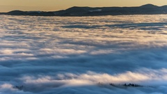 Dense fog rolling through Carpathian mountains. winter landscape Stock Footage