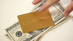 Woman's hand gives and takes away dollars with gold card. Stock Footage