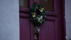 Christmas decoration in England: Wreath on a door Stock Footage