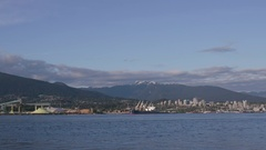 Timelapse. Ship crosses the Burrard Inlet with North vancouver is the Stock Footage