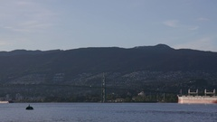 Extreme wide shot of a ship crossing the Burrard Inlet right underneath the Stock Footage