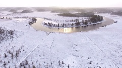 Wild nature of northern Karelia with snow covered swamps and flowing river Stock Footage