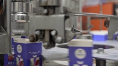 Packing device at dairy plant Stock Footage