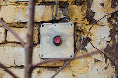 Old, vintage red button on the brick wall Kuvituskuvat