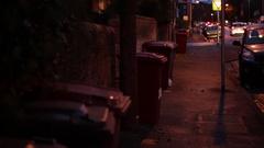 Litter bins in a dark street in Europe Stock Footage