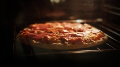 Cook a frozen pizza in a oven. timelapse Stock Footage