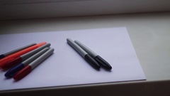 Colored markers on a white sheet Stock Footage
