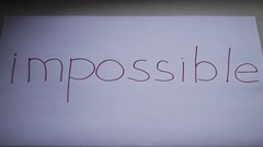 Impossible word gets the ''im'' removed to make it possible Stock Footage