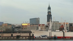 Hamburg, Germany harbor skyline with st. michael's church and subway in sunset Stock Footage
