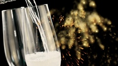 Champagne into flutes with golden abstract glitter sparkle lights fireworks Stock Footage