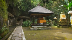 Holy temple in the forest on Bali island. Stone chancel inside tropical garden Stock Footage