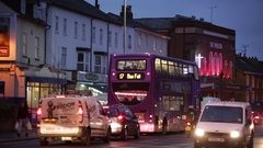 Full bus at night in the busy city in England Stock Footage