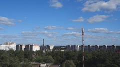 Clouds quickly float above the city buildings with the antenna tower Stock Footage