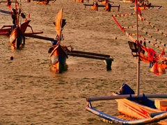Traditional fishing boats near popular tourist destination coast of Bali island Stock Footage