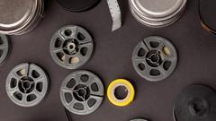 Flat lay pan of vintage film movie reels Stock Footage