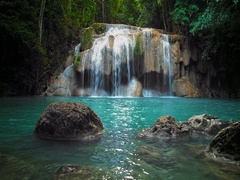 Pristine waterfall with pure clean water pond in tropical forest 4K nature video Stock Footage