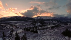Winter Aerial: Sunset Views over Snow Covered Valley and Farms Stock Footage