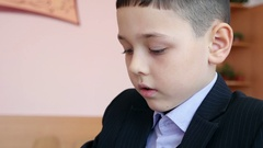 A schoolboy drawing something in his exercise book. Stock Footage