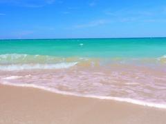 Empty ocean beach on sea shore coast. Outdoor summer vacation background Stock Footage