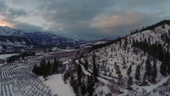 Aerial: Winter Solstice Sunset Over Wintery Rural Valley Stock Footage