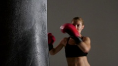 Sportswoman boxer knocks out of the punching bag. Slow motion Stock Footage
