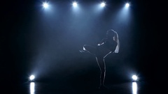 Good stretching girl boxer. Studio in the smoke and spotlights Stock Footage