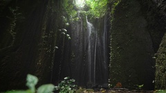 Mysterious waterfall, located in a hidden place of the eyes, lit by sunlight Stock Footage