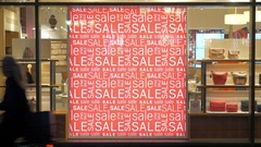 Store front with sale banner illuminated at night Stock Footage