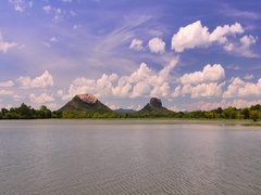 Sigiriya or Sinhagiri ancient rock fortress near Dambulla, Sri Lanka panorama Stock Footage