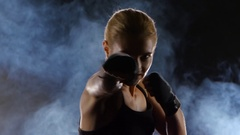 Clear accurate punches towards the camera makes the girl boxer Stock Footage