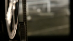 A retro movie projector with moving reels. Small screen. Football. Stock Footage
