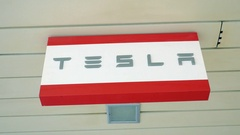 Tesla banner in the store. Automaker of electric cars Stock Footage