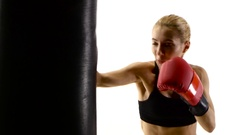 Girl boxer with passion beats his fist on punching bag Stock Footage