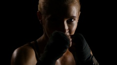 Silhouette of a beautiful woman boxer throwing punches. Close shot Stock Footage