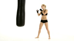 Training with a punching bag at the sportswoman boxer Stock Footage