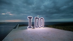 LED letters on the ground near the sea Stock Footage