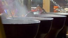 Mulled wine in vats on the Christmas market Stock Footage
