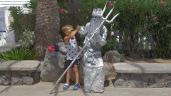 Boy and living statue of Neptune Stock Footage