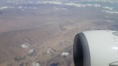 Airplane window view.Impressive lanscape with mountains and clouds. Stock Footage